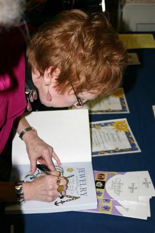 Christie signing her books for members.