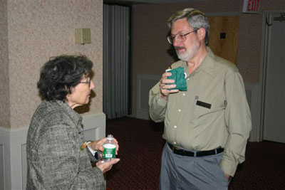 Lois Berger and Denis Nelson trade stories before the meeting