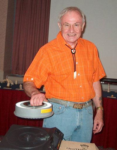 Ivory expert Bobby Mann prepares his slides.