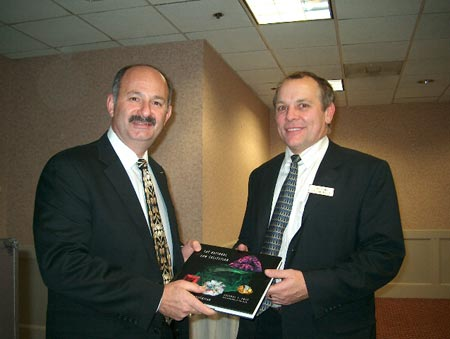 Chapter VP Tony Conway presents our gift Smithsonian book to Bill Boyajian at the end of the meeting.