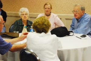 A table of members having a pre meeting discussion
